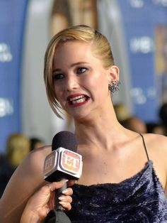 Jennifer Lawrence being interviewed on the red carpet of X-Men.