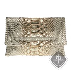 - Gold metallic genuine python and nappa leather envelope clutch  - Made with python skin and backed with nappa leather  - Back zippered pocket  - Magnetic button flap closure  - Main compartment with zipper pouch - Secondary compartment with magnetic button closure - Lined with suede leather    Global Wealth Trade Corporation - FERI MOSH Designer Lines