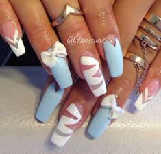 Blue and white nails with bows