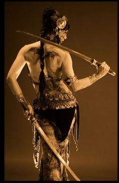 tribal fusion bellydancer bat tattoo swords