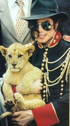 Michael Jackson ~ Animals loved him I think they knew something about Michael that we will never know!
