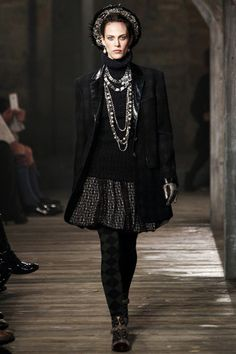PRE-FALL 2013 Chanel / The tweeds, the knits, the cardigans, the man-styled essence of Chanel all came from Scotland and the time that Coco spent there with her lover the Duke of Westminster. But tonight's venue was Linlithgow Palace, where Mary, Queen of Scots, was born almost exactly seven centuries ago, and her tragic life gave Lagerfeld the perfect opportunity to gloss Chanel's easy pragmatism with an element of doomed romance. It was a fantastic combination.