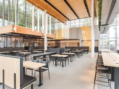 McDonald's opened a new flagship store in Chicago that looks more like an Apple Store than a fast-food restaurant. It features table service, ordering kiosks, and more than 70 trees inside the building. Mcdonalds, Illinois, Mcdonald's Restaurant, Architect Drawing, Architect Magazine, Luxury Interior Design, Commercial Design, Design Firms, Stores