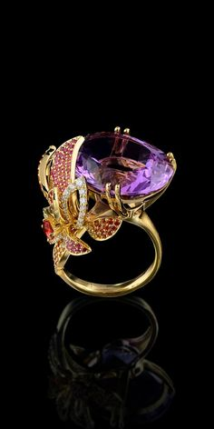 25.80 ct. amethyst, diamond, colored sapphires 18K gold ring