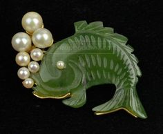 Fish brooch, carved jade, pearls and gold