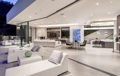 Enjoy the best of indoor outdoor living at this incredible home that features an open floor plan and balconies to enjoy the views below. 8661 Hillside Ave   Sunset Strip