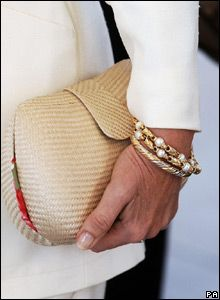 HRH the Duchess of Cornwall wearing some gold and pearl bracelets.