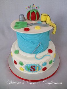 """Sewing Themed Quilt Birthday Cake -      Everything is fondant and edible except for the """"needle"""" parts of the pins in the pin cushion which are floral wire colored with silver food coloring."""