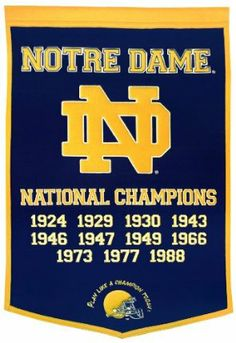 """NCAA Notre Dame Fighting Irish Dynasty Banner by Winning Streak. $49.99. Genuine wool blend fabric.. This unique wool, vintage style banner is decorated with distinctive embroidery and applique detail, and highlights the past National Championships. Ideal as a gift or for decorating an office, gameroom or bedroom.. A uniquely hand-crafted, vintage style, wool banner featuring intricate embroidery and applique design detail.. One 38"""" x 24"""" College licensed wool banner commemorat..."""