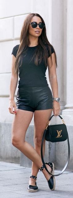 Black vegan leather short shorts paired with black T-shirt Louis Vuitton bag and sandals.. DIY the look yourself: http://mjtrends.com/pins.php?name=vegan-leather-for-shorts_1