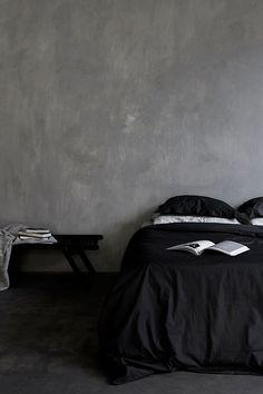 Cozy bedroom in gray hues. Photo by Beeldstein