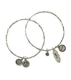 Stack multiple bracelets with multiple charms! Or just wear the bangles stacked with no charms - they look great either way. If you want to spruce them up a little, choose any of our charms and go to town designing your own piece. You can use the alpha charms for initials, or simply have a charm customized with a name then adorn it with other charms.  I love #nelleandlizzie