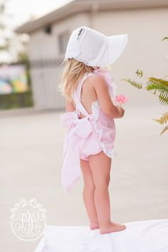 The Catesby Country Club Bonnet was inspired by a vintage baby bonnet pattern that begged T.B.B.C. to bring it back to life. This precious hat has eyelet trim and narrow ties that coordinate with the lining. It's dressy enough for brunch but still practical for the beach. The brim will shade her face while the bonnet will make everyone swoon. Isn't it sweet?!