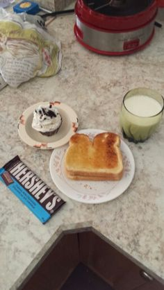 Not much of a lunch, but what can you do. Toast, chocolate bar, glass of milk and blizzard cupcake
