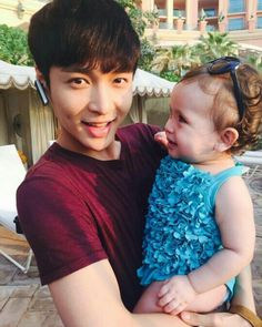 EXO // Zhang Yixing aww laybaby with a baby ^.^