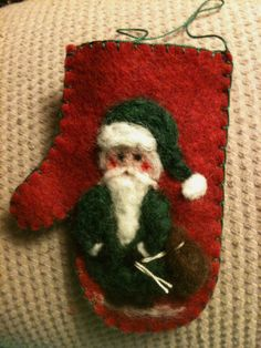 Needle Felted Santa On Red Wool Felt Background Mitten by Sita802, $8.00