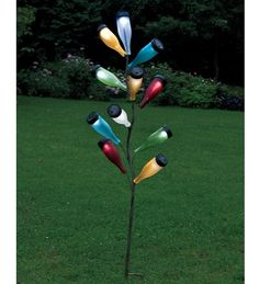 How cool is this metal bottle tree sculpture with colorful solar powered glass bottles! I have a metal bottle tree (filled with wine bottles) but not one with brightly colored solar powered bottles! ☀CQ So making one like this! Wine Bottle Trees, Bottle Lights, Wine Bottle Crafts, Bottle Art, Diy Bottle, Bottle Lamps, Solar Light Crafts, Solar Lights, Path Lights