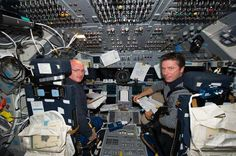 Astronaut Mark Kelly (L) and European Space Agency Astronaut Roberto Vittori aboard Endeavour on STS-134.
