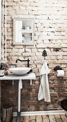 MAIN BATHROOM: White washed brick -- aged and worn floor -- this would be a perfect complement to a simple and chic vanity.