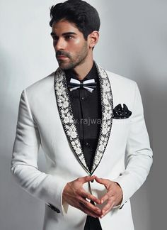 Luxurious White Imported fabric long sleeve blazer is paired with contrast Black bottom material. Fabricated with thread work on lapel will gives you a heart catching look. Suit includes jacket, shirt, bow tie and bottom. Black Suit Bow Tie, Mens White Suit, White Tuxedo, Tuxedo Suit, White Suits, Tuxedo For Men, Mens Suits, Mens Fashion Blazer, Suit Fashion