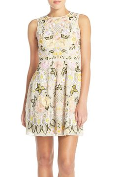 Currently swooning over this floral embroidered fit and flare dress that is  dazzling with beads for 4065616ec