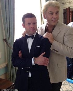 Lol I didn't realise that who there were trying to be!   Hosts: Dermot O'Leary is dressed up as Bond ahead of the awards, while David Walliams is pretending to be Javier Bardem's villain from Skyfall.