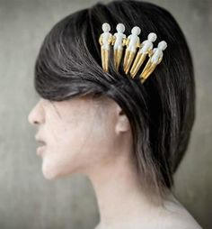 Hair ornament by Yang Qian. Recycled porcelain