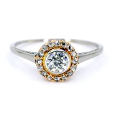 Binenbaum Antiques & Jewelry - This lovely Target ring feature ±0.40ct (H SI1) Old European Cut Diamond surrounded by Rose Cut Diamonds crafted in 18ct. Design Era: Late Victorian (1885-1900). Materials: Diamond, 18ct. Size: 17.93 NL / 56.3 FR / 7¾ US / P UK, sizeable (within reason). Dimensions: H 0.48 x L 0.87 cm.. Weight in grams: 1,9. Condition: Very good condition - slightly used with small signs of wear.