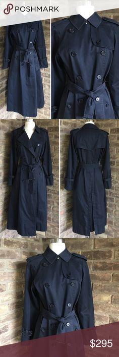 Burberry Navy Blue Trench Coat Size 8 Long Vintage Burberry long navy blue trench coat jacket. This one is a classic. Plaid nova check lined, double breasted, leather wrapped belt and cuff belts, button closure side pockets, button back slit extension.  Great preloved condition, shows signs of wear and dust around the creases/edges, needs to be dry cleaned, button in liner not included, please see photos. Women's size 8 Long, Made in England, 51% cotton 49% polyester.  c005 Burberry Jackets…