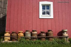 """Love old milk cans! Looking for one right now with a little """"history"""" to it."""