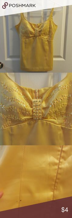 Silky Yellow Sequin Party Top Beautiful silky yellow top with yellow sequins. Small stains on the back but hard to see. No missing sequins. Size Small. This top really brings out your nice tan skin. Looks really cute with short denim skirt! Shansan Tops