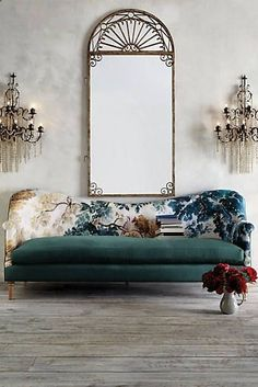 Trending: mismatched upholstery on the sofa--this one boasts a backrest that takes its cue from a verdure tapestry & plush teal seat cushion