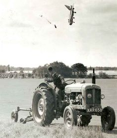Unlike what your first reaction may be, this is a real photograph.   Apparently, a farmer was in the process of snapping a photograph of his buddy riding a tractor in 1962 when, by a billion-to-one chance, he accidentally took an interesting photo instead.  Fortunately, there were no casualties.