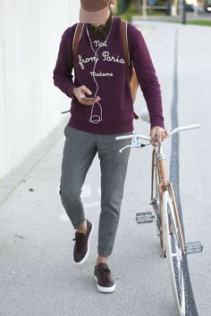 Nail that dapper look with a dark purple print crew-neck sweater and grey trousers. For footwear go down the casual route with dark brown leather low top sneakers. Shop this look for $126: http://lookastic.com/men/looks/dark-brown-low-top-sneakers-grey-dress-pants-dark-purple-crew-neck-sweater-brown-backpack/6122 — Dark Brown Leather Low Top Sneakers  — Grey Dress Pants  — Dark Purple Print Crew-neck Sweater  — Brown Leather Backpack