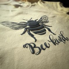 This bee-utifully fitting tee is anything but basic.