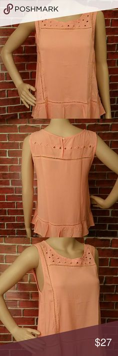 Sale! Peach Relaxed Fit Top Peach Relaxed Fit Top. 100% rayon. Color: Peach. Sleeveless relaxed fit top with round neckline. ** Seller's Discount: 30% off 2 or more items.** Tops