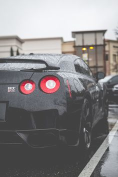 Sexy wet black Nissan GT-R