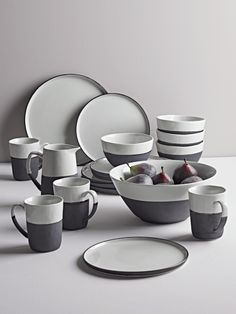 Crafted from stoneware with a soft white glaze and matt black bisque edging, our stylish collection of monochrome dinnerware will look beautiful laid on your dining table or displayed proudly in a glass-fronted cabinet. The combination of col Stoneware Dinnerware, Dinnerware Sets, Dining Ware, Dining Sets, Dish Sets, Ceramic Plates, Kitchen Furniture, Kitchenware, Design