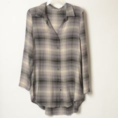 "Chloe K. Plaid Hi-Low Button Up Tunic Like new condition! Brand at Nordstrom Rack & Tilly's. Soft tunic with buttons for a roll up sleeve. Worn a couple times. It's a juniors large, so I would say it fits more of a medium. Measures 31"" from shoulder to front hem, Slightly longer in the back. Great belted with leggings and your favorite boots.  Chloe K Tops Tunics"
