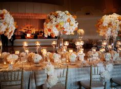 Orange and white fall wedding, floral centerpiece arrangements for the reception! Try something similar and more unique with Tinted Orange and White Roses, found on Bloomingmore: http://bloomingmore.com/