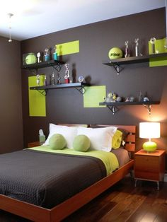 "Jason's room with grey and green.  Likes the green and black wall; doesn't like the bedding because it's ""bubbly"""