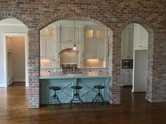 Indoor brick arches framing the kitchen