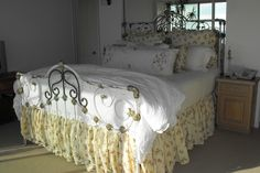 Beautifully converted to king size for Malibu Colony Beach home. circa 1885. #ironbeds #antiqueironbeds