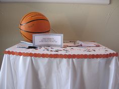 Guests autograph the ball for the baby's room.  #Basketball #babyshower