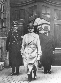 A moody Fuehrer in 1939 with Krause and Otto Dietrich.
