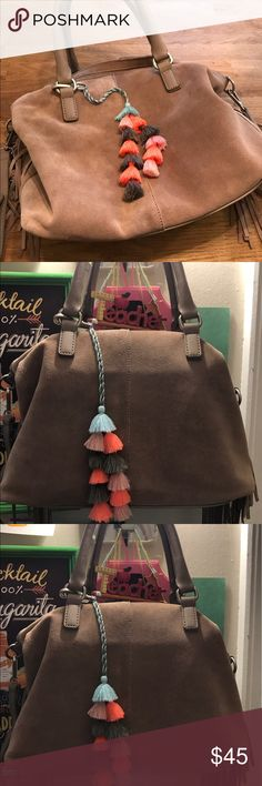 Lucky brand suede fringe satchel handbag This gorgeous suede lucky brand bag will be perfect for those boho summer nights. Has some mild wear which is shown in pics. Come with a removable crossbody long strap. Has also a removable Pom Pom tassel accessory which is brand new and I added because it matched beautifully. Lucky Brand Bags Satchels