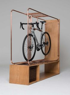 The Stasis bike storage system was collaboratively made by Scottish designer and woodworker Callum Robinson and his local heating engineer Keith Livingstone. Made of copper pipes, oiled Tuscan leather, and Scottish oak, the unit suspends a bicycle above a small shelf and basket. A cyclist's dream, the design is as elegant as it is functional.