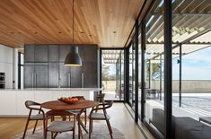 Kitchen looking South Tagged: Kitchen, Medium Hardwood Floor, Accent Lighting, White Cabinet, and Metal Cabinet. St Joseph Beachfront Home by Wheeler Kearns Architects. Browse inspirational photos of modern kitchens. Kitchen Designs Photos, Kitchen Photos, Modern Kitchen Design, Modern House Design, Kitchen Ideas, Kitchen Trends, Michigan Lake House, Wood Cladding, Floor Layout