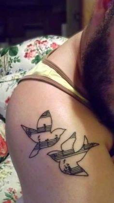 I hate bird tattoos but I like the idea of putting music inside the shape of something else.
