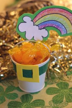"pot of gold at the end of the rainbow. I could put chocolate gold ""coins"" the kids would flip if they woke up with this at their breakfast spot."